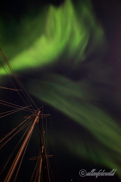 Northern lights with ship's mast