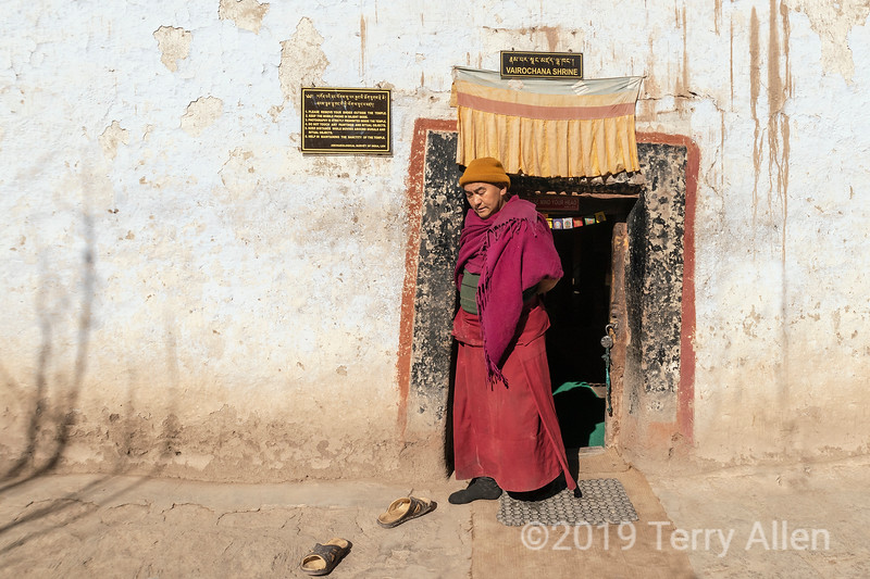 Monk exiting a temple doorway