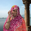 """Portrait of a woman in a sari, Vada Talav lake, Champaner-Pavagadh Archaeological Park, Gujarat, India<br /> <br /> Just before I took the photo, the woman spontaneously reached up her hand, moved aside her veil and smiled at me.<br /> <br /> The hill behind her is Pavagadh Hill, which is also part of this UNESCO site and is a popular place of pilgrimage, drawing thousands of pilgrims a day to the famous 11th C temple of the Goddess Kalika Mata at the top of the hill (pics still to be edited).<br /> <br /> Photos of the beautiful 16th century Jami Masjid (masjid means mosque), which is a blend of Hindu and Moslem architecture, can be seen here: <a href=""""http://goo.gl/JWuvJH"""">http://goo.gl/JWuvJH</a><br /> <br /> 31/10/13  <a href=""""http://www.allenfotowild.com"""">http://www.allenfotowild.com</a>"""