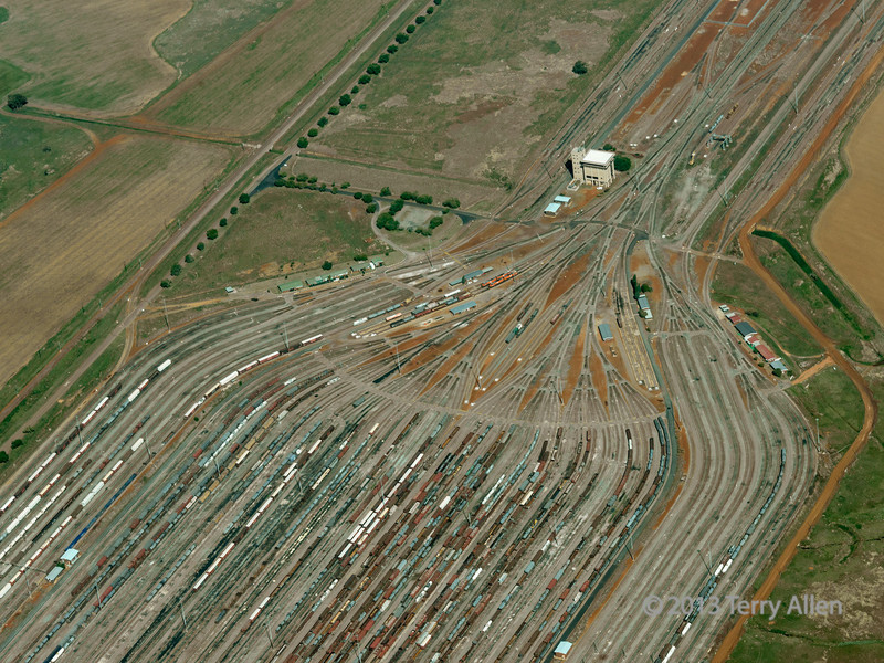 Kazerne marshalling yard from the air, near Johannesburg, South Africa (best seen at the largest sizes)<br /> <br /> From your posts, I know that many of your are railroad buffs.  I saw this gigantic rail yard from a small plane on the way to Johannesburg, returning from safari, and was captivated by the shape of the converging rails and the huge numbers of rail cars.