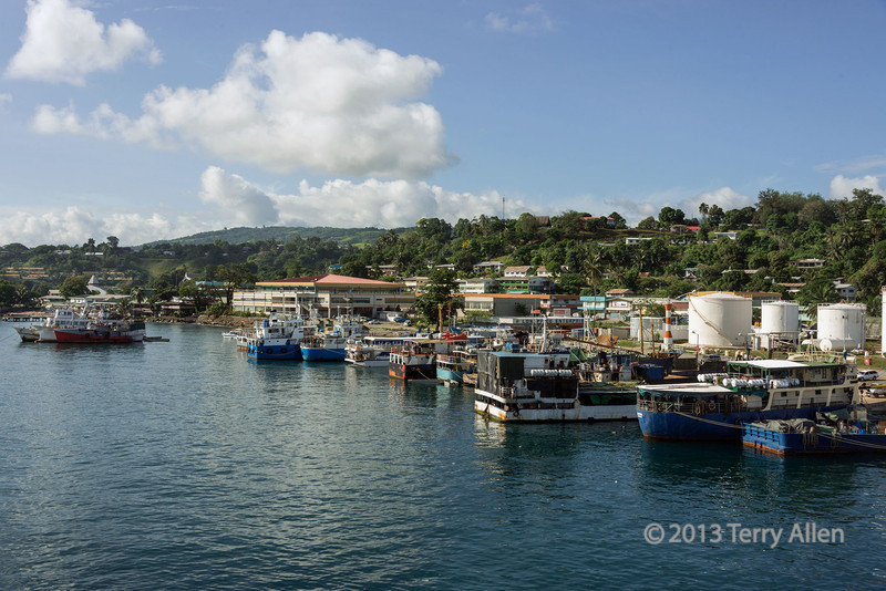 """Local boats in Honiara harbour, Guadalcanal Is, Solomon Islands (best larger)<br /> <br /> Honiara is the main city on Guadalcanal.  It owes its existence to the huge military supply depot that the USA built in this bay in 1943.  To support the Allied war efforts in the north-western Solomons, the USA constructed wharves, roads and storage sheds and completed Henderson airfield, which is now the international airport for the island.<br /> <br /> Other photos of the shipping and harbor can be seen here: <a href=""""http://goo.gl/DXqurj"""">http://goo.gl/DXqurj</a><br /> <br /> 02/12/13  <a href=""""http://www.allenfotowild.com"""">http://www.allenfotowild.com</a>"""