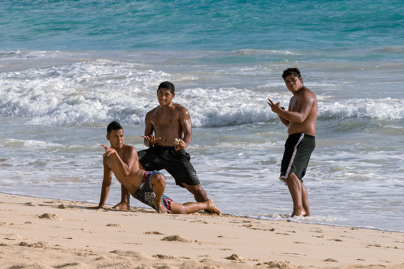 "The beach boys<br /> <br /> Hawaiians hamming it up for the camera, Waimanolo Beach, Oahu. At larger sizes you can see the small crab the middle guy is holding.<br /> <br /> Other shots from around Oahu can be seen here: <a href=""http://goo.gl/vXd54l"">http://goo.gl/vXd54l</a>"