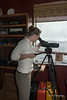 """Volunteer at Cetacea Lab at spotting scope looking for whales in Whale Channel, Gil Island, mid-coast British Columbia<br /> <br /> Humpback whales, killer whales, and fin whales (and even a rare right whale this summer) frequent the waters around Gil Island. These are dangerous waters with high winds, strong tides and currents and uncharted reefs. The BC ferry 'Queen of the North' went aground and sank off the north end of Gil Island in 2006, with the loss of 2 lives. The whales are in an environmentally sensitive area and will be endangered by any oil spills from tankers should the Northern Gateway pipeline be built out to the coast near here.  The Cetacea Lab is a non-profit organization devoted to the research and protection of whales in the waters of the Great Bear Rainforest.  Their web site is here with some fascinating acoustic recordings of whale sounds: <a href=""""http://www.forwhales.org"""">http://www.forwhales.org</a><br /> <br /> Other photos of the lab and some humpback whales we saw in the area are here: <a href=""""http://goo.gl/lw2twZ"""">http://goo.gl/lw2twZ</a><br /> <br /> Update re Art's question: Spotting scopes, unlike many telescopes, create a right way up and right way round images. You generally get a clear crisp image for land viewing including objects such as mountains, trees, birds, animals and even whales.  Telescopes are less rugged and less portable and are designed more for sky viewing where orientation and portability are not as important.<br /> <br /> 1/11/13  <a href=""""http://www.allenfotowild.com"""">http://www.allenfotowild.com</a>"""