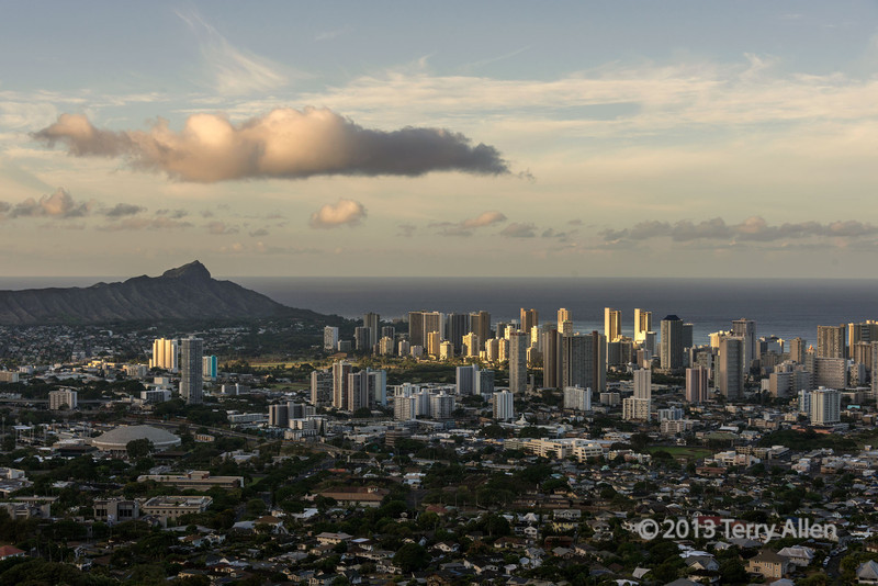 """A new day!<br /> <br /> Sunrise taken from the hills overlooking Diamond Head and Waikiki, Honolulu, Oahu.  The rising sun is just starting to hit the high rise  buildings.<br /> <br /> Other sunrise and sunset shots can be seen here, plus a cool late evening shot of the lights of Waikiki: <a href=""""http://goo.gl/7MSuuU"""">http://goo.gl/7MSuuU</a>"""