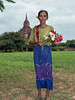 Portrait of a woman bringing a flower offering to Sulamani Temple, Bagan, Myanmar