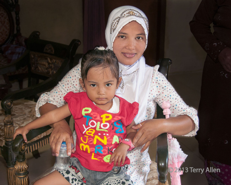 Portrait of a Minangkabau mother and child, Solok, West Sumatra<br /> <br /> Never did find out what the T-shirt says.
