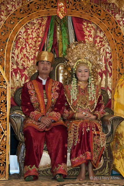 """Caught them trying to stifle a smile!<br /> <br /> Minangkabau bride and groom, Cupek, West Sumatra<br /> <br /> The Minangkabau people are traditionally very solemn when their photos are taken, for example, see here: <a href=""""http://goo.gl/pLQq0N"""">http://goo.gl/pLQq0N</a><br /> I finally managed to capture the bride and groom smiling.<br /> <br /> 23/09/13  <a href=""""http://www.allenfotowild.com"""">http://www.allenfotowild.com</a>"""