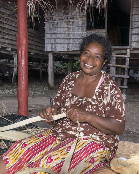 """Woman preparing to weave a basket, Bonarua Is, Brumer Islands, PNG<br /> <br /> For making crafts, the division of labour is quite strict: women do the weaving; men do the carving. Sound familiar?<br /> <br /> Other photos from the Brumer Islands can be seen here: <a href=""""http://goo.gl/XSFrC"""">http://goo.gl/XSFrC</a><br /> <br /> 24 mm, 1/60 sec, f 7.1, ISO 640, FF"""