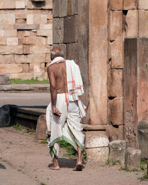 """Mahatma Gandhi look alike?<br /> <br /> Barefoot man wearing dhoti passing through the East Bhadra Gate, Champaner, Gujurat.  Other photos from the local area can be seen here: <a href=""""http://goo.gl/jjRdUr"""">http://goo.gl/jjRdUr</a><br /> <br /> 30/09/13  <a href=""""http://www.allenfotowild.com"""">http://www.allenfotowild.com</a><br /> <br /> Note: I'm heading up into my 'backyard' for a few days to try to catch some shots of grizzly bears feeding up for winter on the salmon streams.  My ability to post and comment may be limited."""