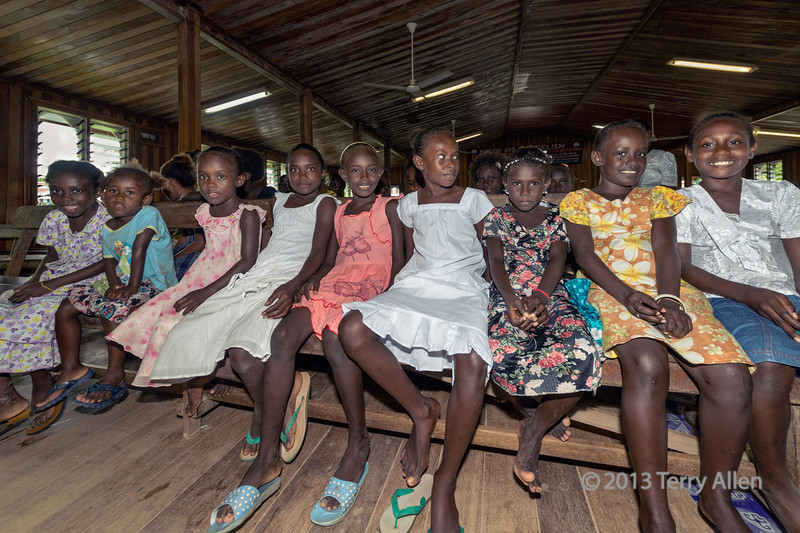 """Girls at Sunday school, Wesley United Church, Ghizo Island, Solomon Islands<br /> <br /> Its been a while since I posted shots from Melanesia, and I still haven't made public any shots from the Solomon Islands, the Santa Cruz Islands and Vanuatu. Ghizo Island was our first stop in the Solomon Islands.<br /> <br /> The girls are dressed in their best for the Easter Sunday service that followed Sunday School (I stayed for the service and the singing was MAGNIFICENT).  Since this is an island with a lot of missionary influence, even out of church the girls and women are often dressed in mumus (link below).<br /> <br /> Other photos from Ghizo Island can be seen here: <a href=""""http://goo.gl/iyGcJs"""">http://goo.gl/iyGcJs</a><br /> <br /> 27/11/13  <a href=""""http://www.allenfotowild.com"""">http://www.allenfotowild.com</a>"""