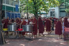 """Monks lining up with their bowls to receive their midday meal, Mahagandayon Monastery, Amarapura, Myanmar<br /> <br /> Other shots of the monks can be seen here: <a href=""""http://goo.gl/YHw9mv"""">http://goo.gl/YHw9mv</a><br /> <br /> 27/09/13  <a href=""""http://www.allenfotowild.com"""">http://www.allenfotowild.com</a>"""