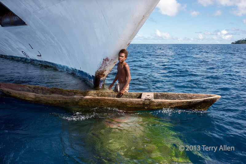 """Giant ship: tiny boat!   Boy with dugout canoe standing on the algae-covered bulb of Clipper Odyssey, Utupua Island, Solomon Islands<br /> <br /> COMMENT about the lack of representation of woman photographers among the award winners in major photography competitions:<br /> <br /> I went to the National History Museum yesterday in London, UK, to see the Wildlife Photographer of the Year Award photographs.   <a href=""""http://www.nhm.ac.uk/visit-us/wpy/gallery/2013/index.html"""">http://www.nhm.ac.uk/visit-us/wpy/gallery/2013/index.html</a>).  As usual the photographs were wonderful......and as usual 99% of the awards were received by men!!  Only two women won prizes out of ~240 winners.  I have nothing against men that take wonderful wildlife photos and enjoy seeing their work.  I just wonder why women are not recognized for their excellent photos.  In other years when I have gone to this exhibition, it has been exactly the same.<br /> <br /> So why is this?  I doubt that there is bias against women on the jury, since many of the jurors are women.  I also doubt it is because women aren't capable of taking award winning photos, or don't have the equipment or the technical know how to do so (as our many talented lady smugmuggers clearly demonstrate). I also don't think is is because women don't travel to the exotic places where these types of photos can be taken. In my travels  the women usually outnumber the men.<br /> <br /> So I concluded that it is because, for whatever reason women photographers are not entering these contests, maybe for lack of time, maybe for lack of confidence, maybe because they are unaware of them, or maybe because they can't be bothered playing that particular game.<br /> <br /> I must confess that I never enter contests, since I am too busy with my 'real' career to spend the extra time and effort for a very small chance of winning, and since, I admit, that I am not confident enough about winning to 'waste' the time applying. And I don't approve"""