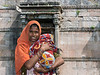 """Portrait of a mother holding her young baby, wrapped in a blanket, Champaner, Gujarat, India<br /> <br /> Other photos of the local people, including a portrait of a thoroughly modern young girl, can be seen here: <a href=""""http://goo.gl/74PpXI"""">http://goo.gl/74PpXI</a><br /> <br /> 6/11/13  <a href=""""http://www.allenfotowild.com"""">http://www.allenfotowild.com</a>"""