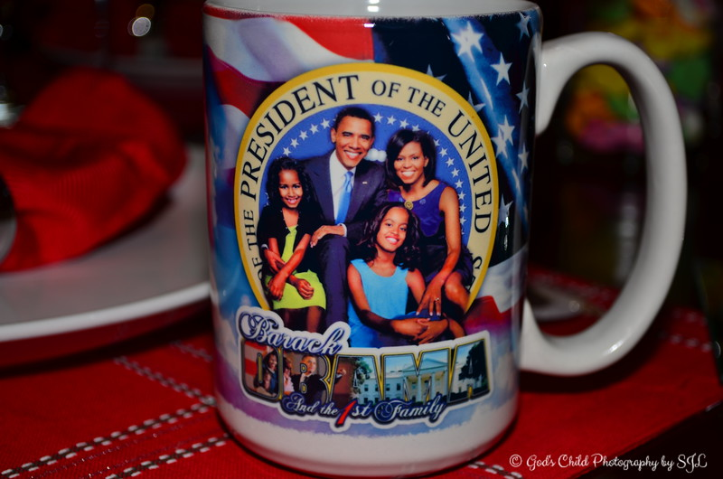 "Monday, February 18, 2013   ""COFFEE WITH THE FIRST FAMILY""   ""Of all the rocks upon which we build our lives, we are reminded today that family is the most important."" ~ President Barack Obama, the 44th and first African-American President of the United States of America  DISCLAIMER: The fact that I posted this photo today does not mean that I voted for or did not vote for Barack Obama. As a citizen of the United States, I make a concerted effort to post a photo in honor of all USA holidays / special event days on the day that they occur. Any comment that is soap box in nature, derogatory, and/or a personal attack against the President, First Lady, and/or their girls will be deleted. Amen!  Photo posted in honor of President's Day & African-American History Month. In January 2009, the beginning of Mr. Obama's first term, my best friend sent me this mug and a tee shirt that features a collage of photos of the president in a variety of settings. In 2008, I was invited to Barack Obama's Presidential Election Campaing at Jackson State University as a VIP guest, compliments of a former colleague (Georgetown graduate) whom I mentored for two years. At that time, he was working on the campaign; after Obama's election, he became a full-time employee with the Obama Administration, where he currently works.   God, bless America; America, bless God!   ***#29 photo of the day***  (photo taken 2/12/2013)"