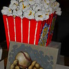 "Monday, September 23, 2013     ""MOVIE POPCORN"" (red carton) by Betty Spindler  (Ceramic - 14 X 7 X 7 - $1,650.00)  ""Every once in a while, someone will mail me a single popcorn kernel that didn't pop. I'll get out a fresh kernel, tape it to a piece of paper, and mail it back to them."" ~ Orville Redenbacher    This still life and work of art was viewed and photographed at night from behind the glass of Scottsdale Fine Art. I pointed the camera as close to the window as possible and snapped only this shot.   Betty Spindler's official website is here: http://www.scottsdalefineart.com/spindler-betty.html  Wow! There were a plethora of creatively interesting photo submissions for ""K"" day. I don't think there were any duplicate subject matter. I am ready for ""L"" day; are you? By the way, who will initiate the next ""challenge?""  SmugMuggers rock and ""pop!""   Have a marvelous Monday.  Scottsdale Fine Art 7116 E. Main Street (Old Town Scottsdale's Arts District) Scottsdale, AZ 85251 Official website is here: http://www.scottsdalefineart.com/  ***#13 photo of the day***  (photo taken July, 2013)"