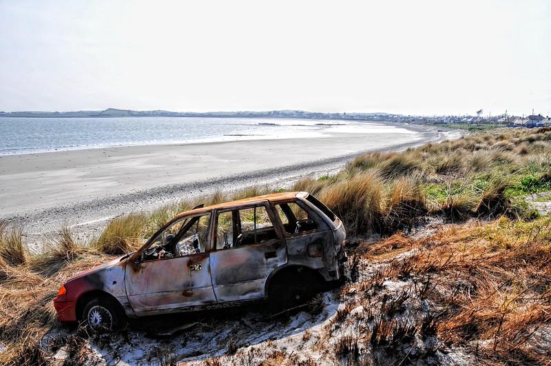 Burnt-out car<br /> Cloughey Beach<br /> County Down