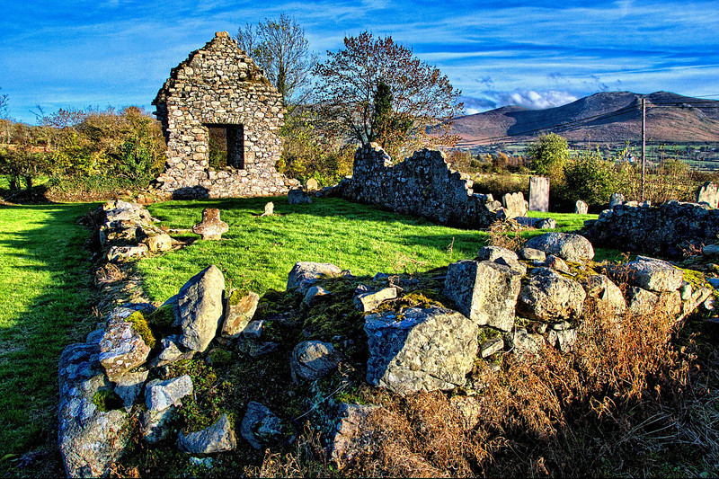 The old chapel & graveyard in Ballyaughian townland, on the road to Bryansford, County Down. The Mourne Mountains can be seen in the distance.