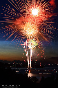 "July 5th - ""Independence Day""  Flathead Lake, MT I love fireworks!  Ever since I was a kid I loved the celebrating the 4th of July and experiencing the excitement of fireworks.  As I have grown older I have found a new way to experience fireworks by capturing them with my camera.  I shot this image a few years back while visiting my family in Montana.  I camped out at this spot for 2 hours to secure this view. Technical Details: Shot with Canon 30D and Canon 20mm lens at F10 and 10 seconds."