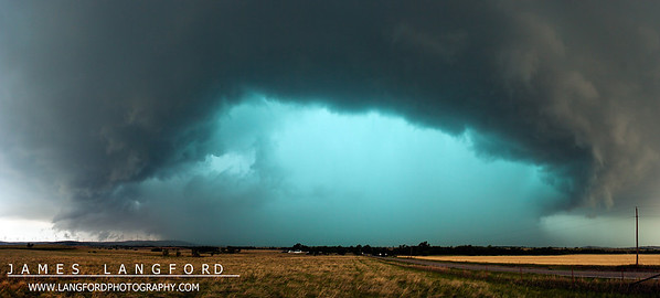 "July 6th - ""Green Monster Core""  South-Western Oklahoma  One of my favorite hobbies after photography is storm chasing.  Experiencing the power and beauty of thunderstorms is something that is really hard to translate into images.  My chase partner and I came upon this HP supercell in South-Western Oklahoma one evening.  The rain and hail in the core of the storm gave it this amazing green light.  You couldn't even see the colors until the storm was practically on top of you. Technical Details: Shot with Canon 30D and Canon 10-22mm lens at F10 and 1/8.    Panorama created from 24  vertical bracketted shots."