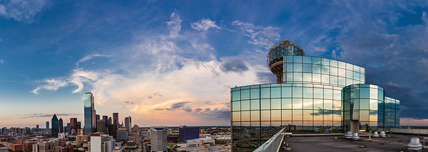 "July 25th - ""Big D""  Dallas, TX There is something incredibly peaceful about being on top of a building overlooking a busy city as the sweet light of evening comes on.  Even with all the hustle, bustle and noise of the city places can be found that offer a breathtaking vantage point.  Technical Details: Shot with a Canon 5d Mk2 and a Canon 24-70mm lens at F10 and 30 seconds."