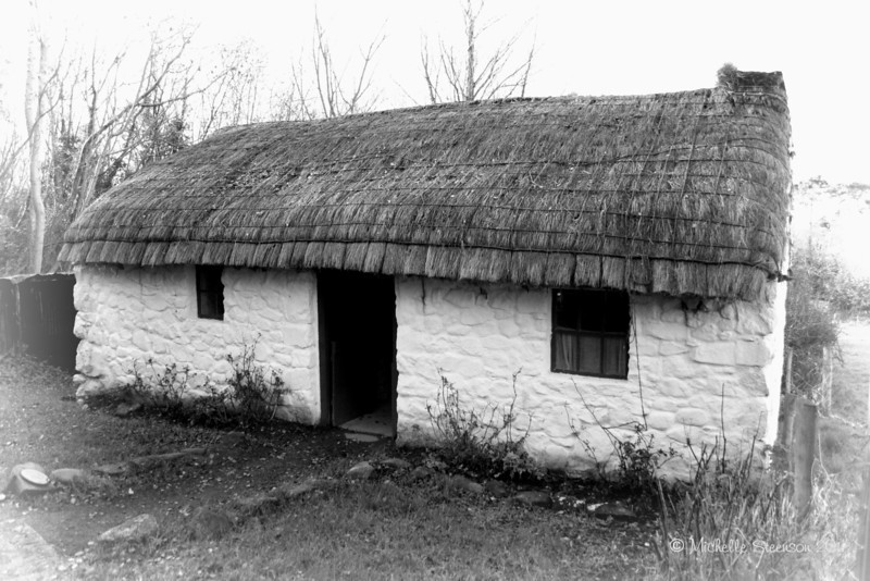 An old Irish cottage with thatched roof. Ballycultra, County Down