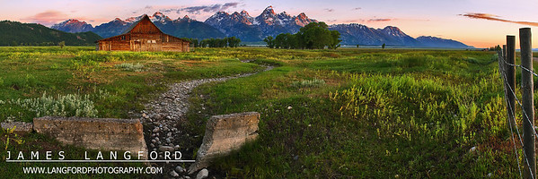 "June 27th - ""Another Glorious Morning in the Tetons""  Grand Teton National Park, WY  I captured this while visiting Grand Teton National Park a few years back.  I wanted to capture the grandeur and scale of this scene, and so chose to shoot in a panormaic format.  I wanted a slightly different view on this beautiful old barn, and chose to incorporate the path and wall to more fully pull the viewer into the scene.  Technical Details: Shot with Canon 10D and Canon 20mm lens at F10 and 1/8.    Panorama created from 6 horizontal shots."