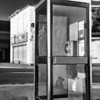 Modern telephone booth with old building in the background