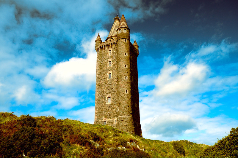 "Scrabo Tower<br /> Newtownards<br /> County Down<br /> Post Date: 6th September 2013<br /> <br /> Scrabo Tower (Irish: Túr Scrabo) is located to the west of Newtownards in County Down, Northern Ireland.<br /> <br /> The landmark, which is visible from most of north Down, was built above the town in 1857 as a memorial to Charles Stewart, 3rd Marquess of Londonderry who was one of the Duke of Wellington's generals during the Napoleonic Wars. The 3rd Marquis, or ""Warring Charlie"" as he was also known, inherited the title and family seat of Mount Stewart after his brother, the 2nd Marquis, committed suicide. The 2nd Marquis is better known as Viscount Castlereagh, the politician who served a term as Britain's Secretary of State for Foreign Affairs.<br /> <br /> The tower was built to designs attributed to Charles Lanyon and WH Lynn and now stands in a country park. The park has several woodland walks and parkland through Killynether Wood. The view from the hill and the summit of the tower extends across Strangford Lough, scattered with its many islands, to the Mountains of Mourne and the Scottish coast. The tower houses two floors of displays and a climb of 122 steps takes the visitor to the open viewing level. Scrabo Country Park is always open, admission to the park and the tower is free.<br /> (Courtesy Wikipedia)"