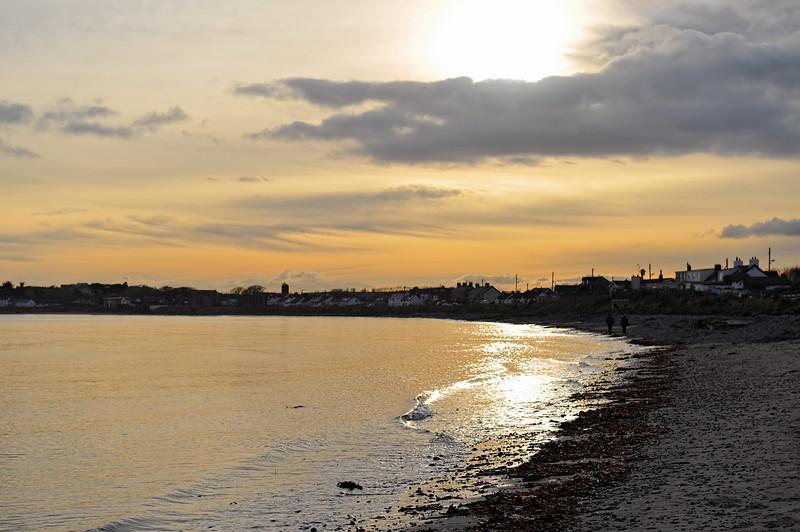 Mid-winter sun on a cold Cloughey beach