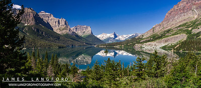 "July 10th - ""Reflection Perfection""  Glacier National Park, MT Technical Details: Shot with Canon 30D and Canon 10-22mm lens at F10 and 1/60.    Panorama created from 10  vertical shots."