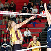 Bishop Carroll's Sarah Gomish (13) blocks a kill attempt by Elk County Catholic's Carli Schneider Saturday in the quarterfinals of the PIAA Class A volleyball tournament at Punxsutawney High School. Bishop Carroll won the match, 25-18, 25-19 and 25-17. (Photo by Scott Shindledecker)