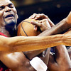 Oklahoma City Thunder's Thabo Sefolosha, left, and Kendrick Perkins, right, defend against Miami Heat's Chris Bosh, center, during the first half of an NBA basketball game, Tuesday, Dec. 25, 2012, in Miami. (AP Photo/J Pat Carter)