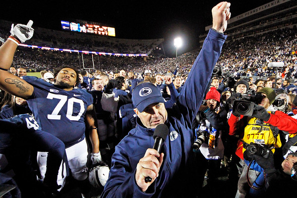 FILE - In this Nov. 24, 2012, file photo, Penn State head coach Bill O'Brien, center, celebrates with his team after their 24-21 overtime win over Wisconsin in an NCAA college football game in State College, Pa. The reverberations from the Penn State child sex abuse scandal was selected as the sports story of the year by United States editors and news directors in an annual vote conducted by The Associated Press, marking the first time that the same issue was selected in consecutive years since the AP began announcing a sports story of the year in 1990. (AP Photo/Gene J. Puskar, File)