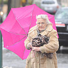 Strong winds and heavy rain caused Dolores Ovellette, Johnstown umbrella to turn inside out as she was running errands in downtown Johnstown, Pa.(Ap Photo/ Todd Berkey/ Johnstown Tribune-Deomcrat ).