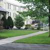 A family takes a summer walk along Luzerne Street near the Westmont Middle school