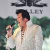 Elvis Presley impersonator Peter Alden performs at the gazebo in Central Park.