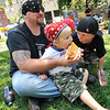 Michael Tomalson of New Florence feeds his son Keydun,2, while his other son Traystin,7, antagonizes his brother.