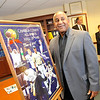 Bruce Haselrig stands beside a poster of the seven 2012 inductees to the Cambria County Sports Hall of Fame on Wednesday at the offices of lawyer D.C. Nokes in Johnstown.
