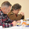 Jan Burns, right, and husband Bob of Monroeville.,PA., pray before eating their Thanksgiving dinner at the Westmont Grove in Johnstown, PA., Thursday, Nov.22, 2012. The dinner was open to the public.(AP Photo/Tribune-Democrat, John Rucosky).