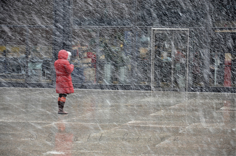"""""""Little Red Riding Hood""""<br /> <br /> Daily Photos  -  January 13, 2012<br /> <br /> One of the few people out braving Chicago's first real snow of the season..."""