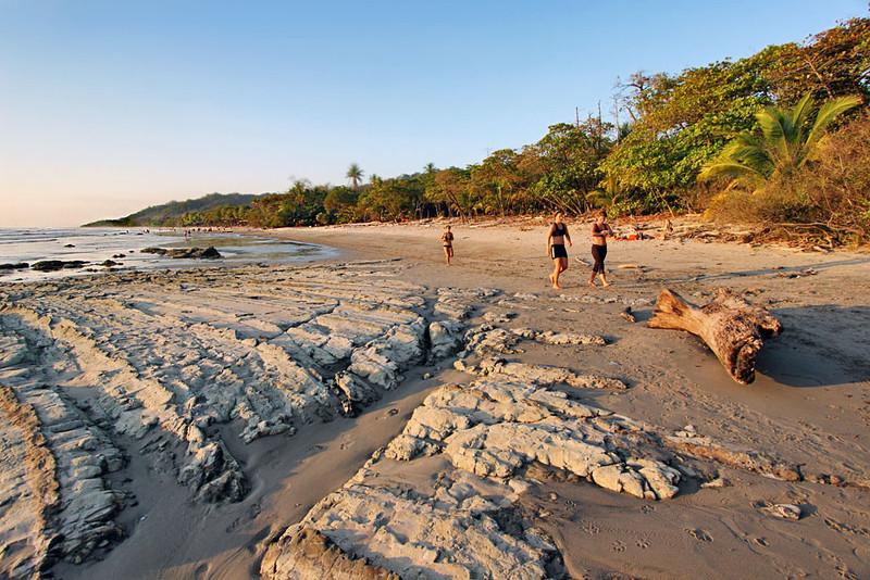 Rocky outcroppings on Santa Teresa Beach on Nicoya Peninsula of Costa Rica