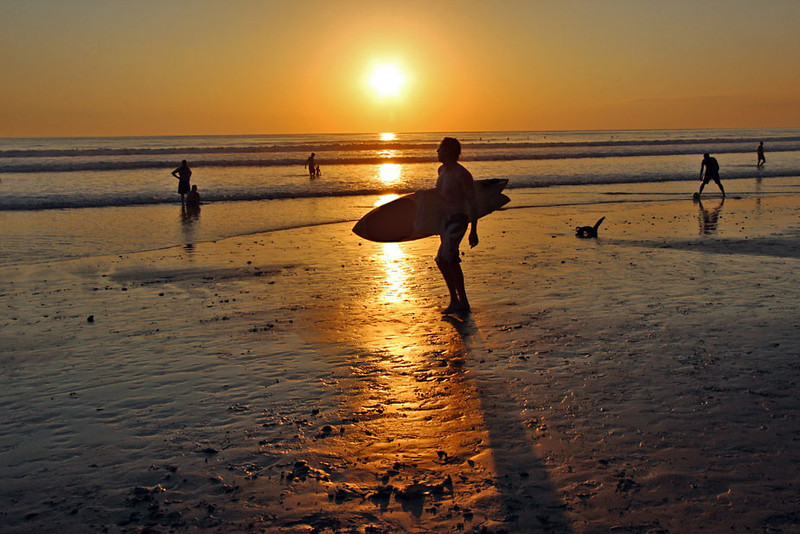 Catching the last waves before the sun sets near Mal Pais on the Nicoya Peninsula of Costa Rica