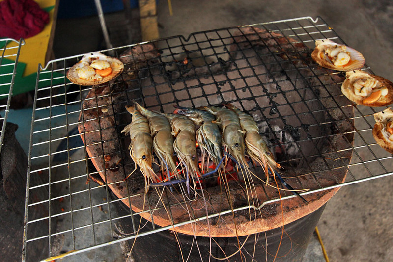 Fresh caught giant shrimp cook on charcoal grill in Hua Hin, Thailand
