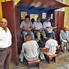 Men getting a shine in Trujillo, Peru are all smiles for my camera