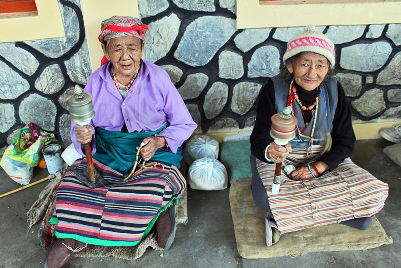 Women spin wool at Lodrik Old Folks Home at Jampaling Tibetan Refugee Settlement near Pokhara, Nepal