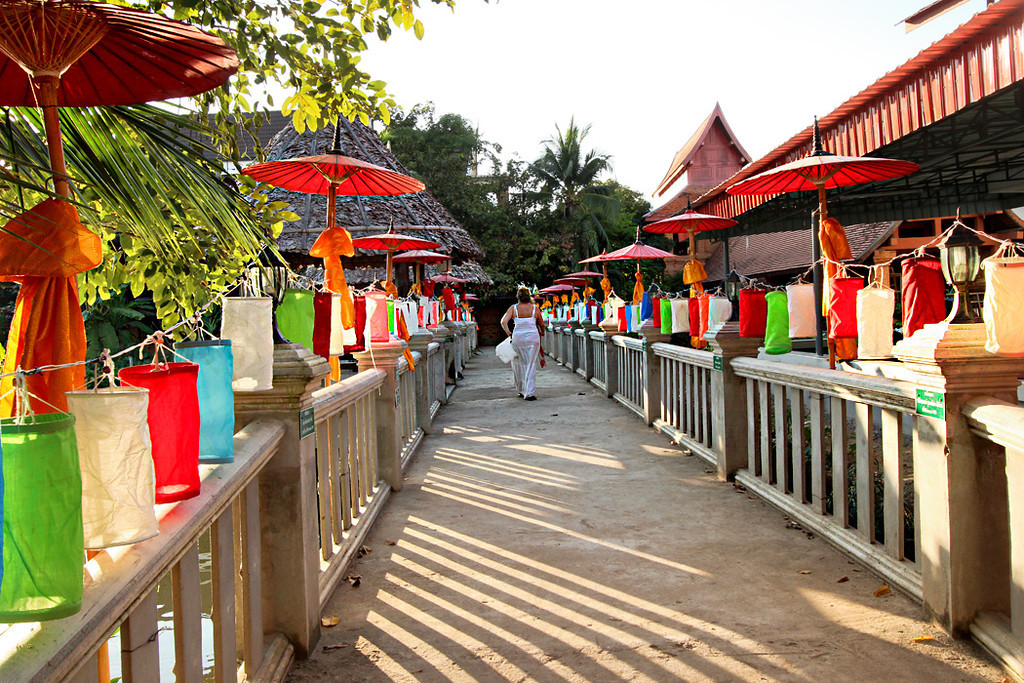 Lanterns and umbrellas decorate walkway to monks' quarters at Wat Jetlin in Chiang Mai, Thailand