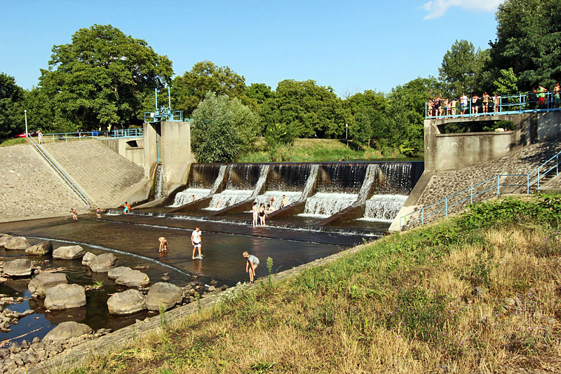 Swimming at the spillway on the Tur River, which forms the boundary between Hungary and Ukraine