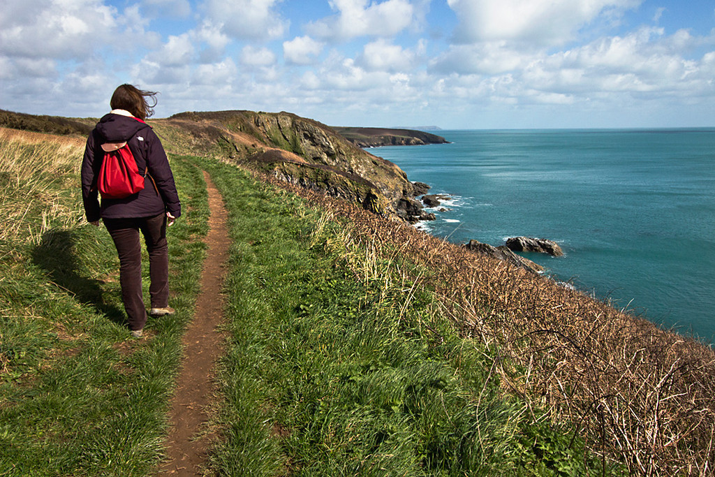Hiking the South West Coast Path around Saint Anthony Head in Cornwall, England