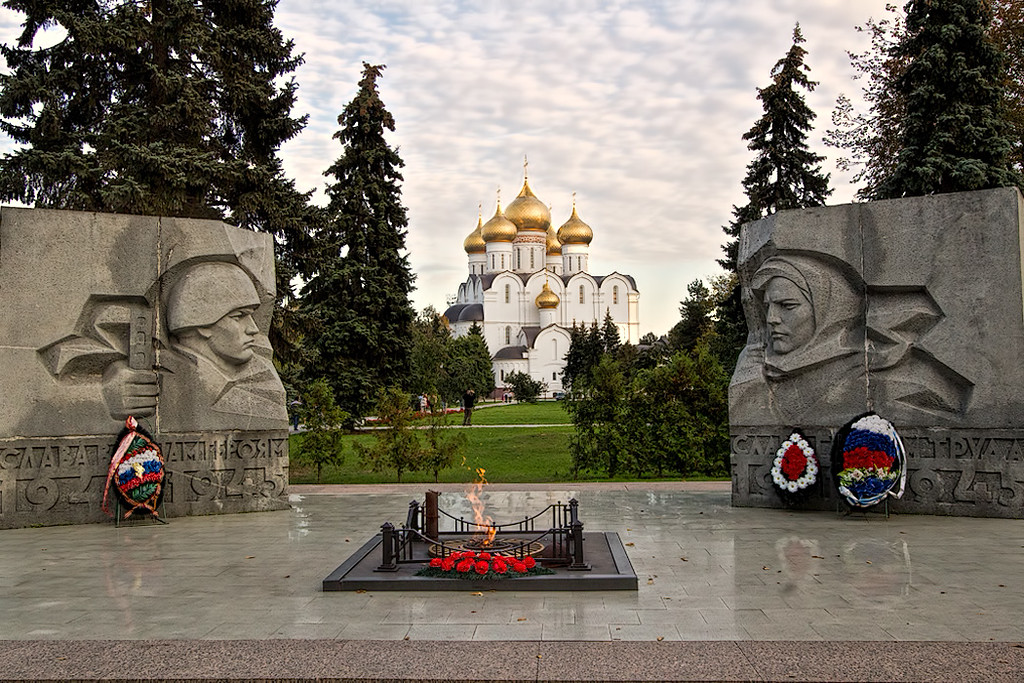 WWII Memorial and eternal flame frame the Church of the Assumption in Yaroslavl, Russia