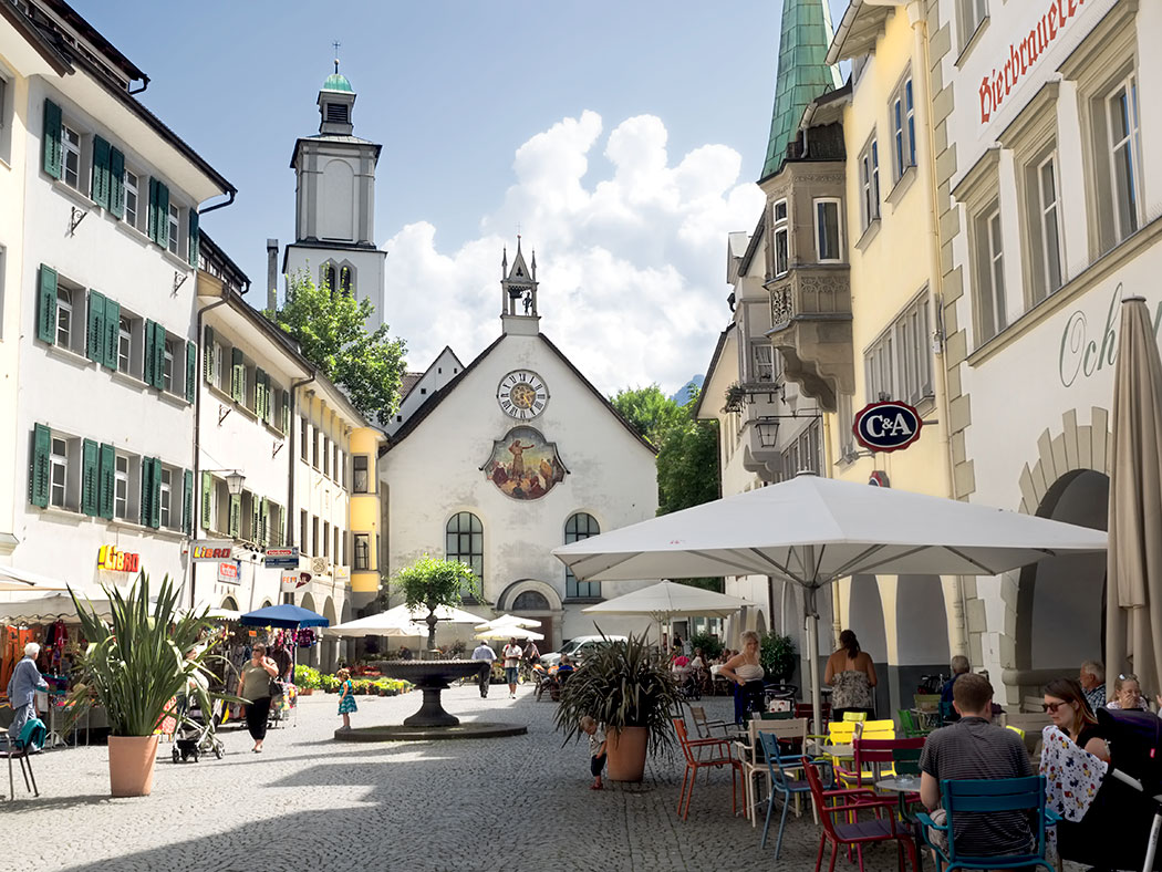 Historic St. Johann Church anchors one end of Marktplatz in the medieval Old Town of Feldkirch, Austria